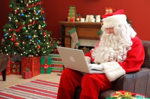 Santa Claus working on laptop computer