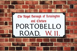 Portobello Road sign in the street market at Notting Hill, Kensington, London, England, UK