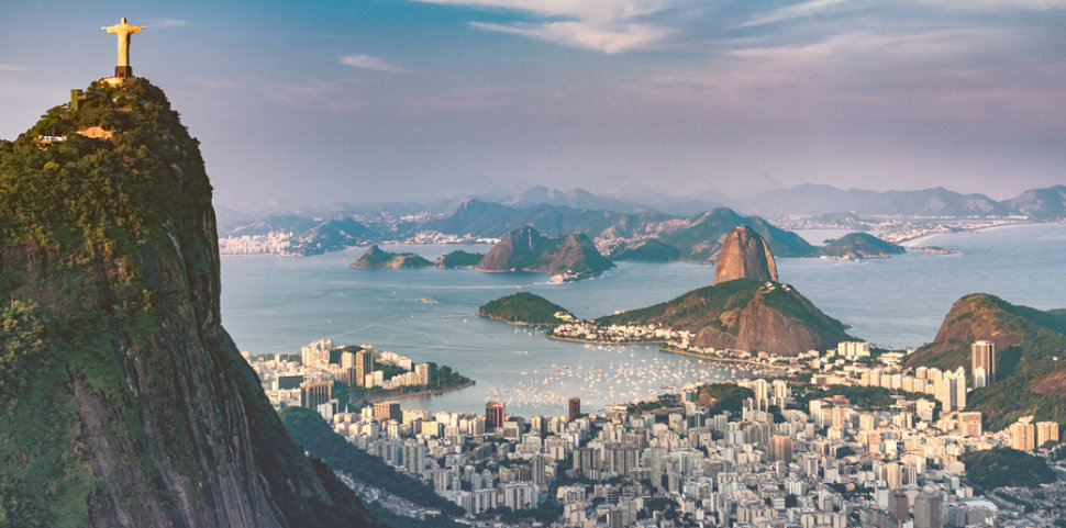 Aerial view of Rio De Janeiro. Corcovado mountain with statue of Christ the Redeemer urban areas of Botafogo and Centro Sugarloaf mountain.
