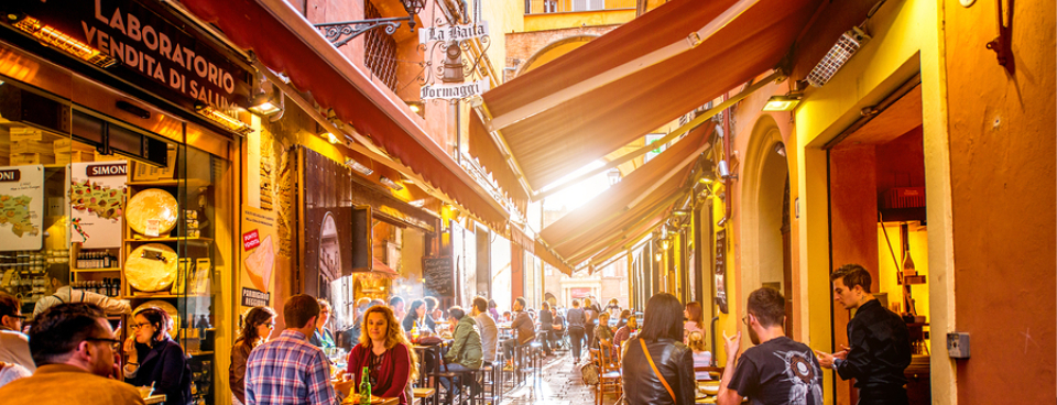 Enjoy lunch on Pescherie Vecchie street near the famous italian food markets and shops in the center of old town Bologna.