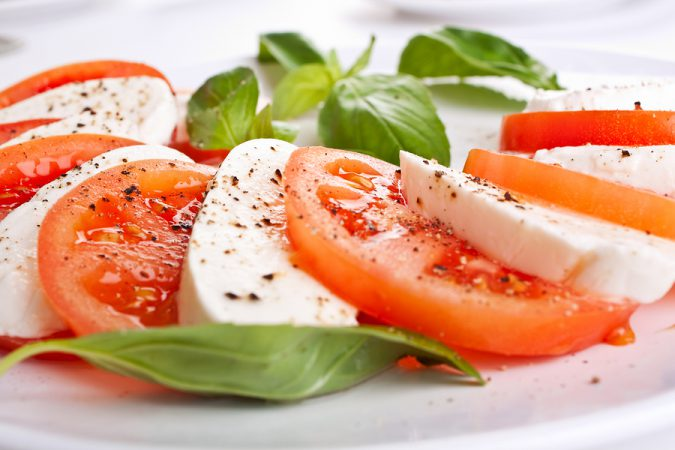 Caprese Salad - healthy ingredients like tomatoes, olive oil, herbs, vegetables, beans and lean proteins like chicken and seafood, it's a great place for health-conscious foodies.